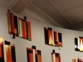 """Secuencia de una Intención Plástica (25 paneles decorativos realizados para el Auditorio del Hotel Aristos),1968, Carlos Mérida, caoba laqueada y dorada, colección Leopold Klachky, exposición """"Carlos Mérida. Retrato escrito (1891-1984)""""."""